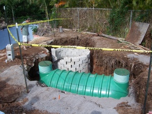Photo showing a septic tank and a seepage pit.