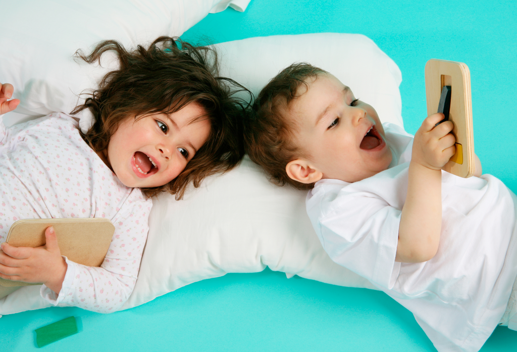 two laughing kids lying down