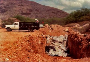 Disposal of asbestos containing materials at an approved landfill.