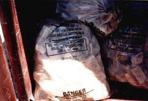 Asbestos-containing waste material.