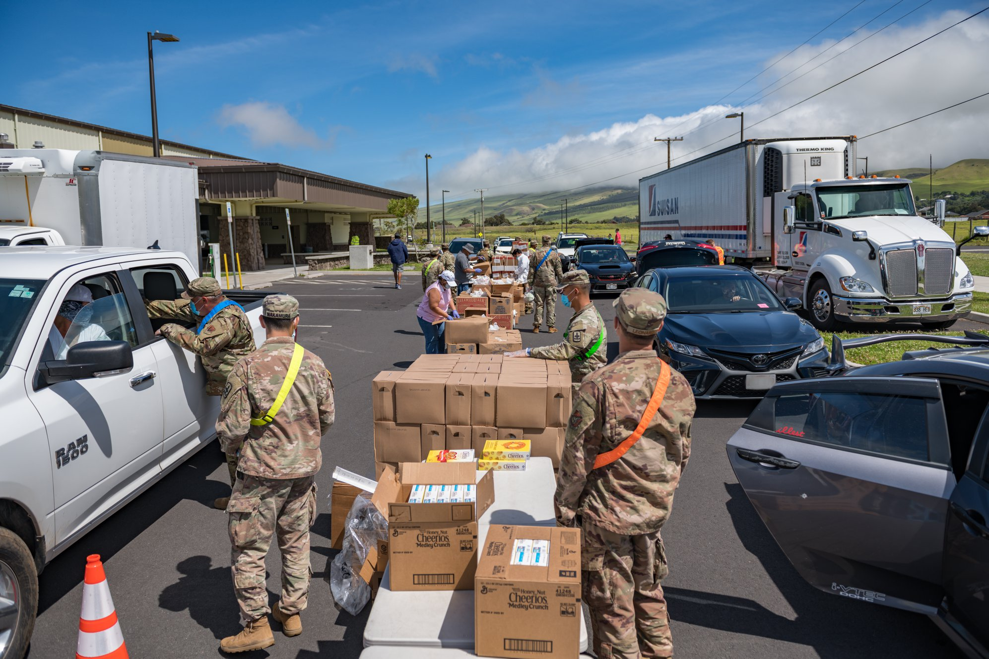 row of boxed supplies Hawaii Public Housing Authority - Hawaii Department of Health and Hawaii Air National Guard