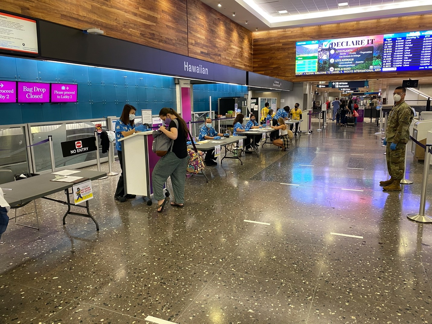 Travelers at Hawaiian Airlines Terminal
