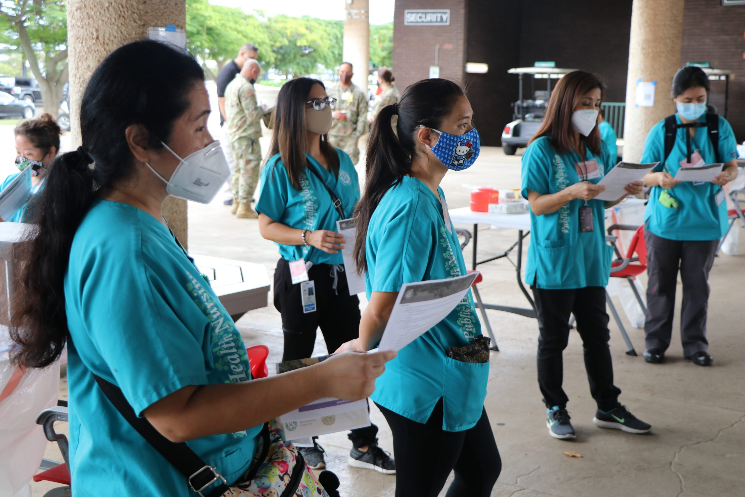 health care workers receive training on vaccine distribution
