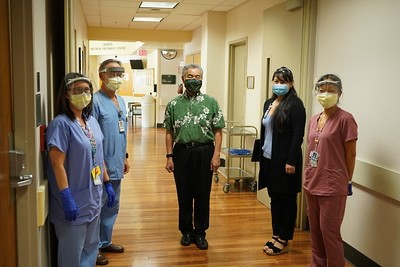 people pose for a photo in a medical building
