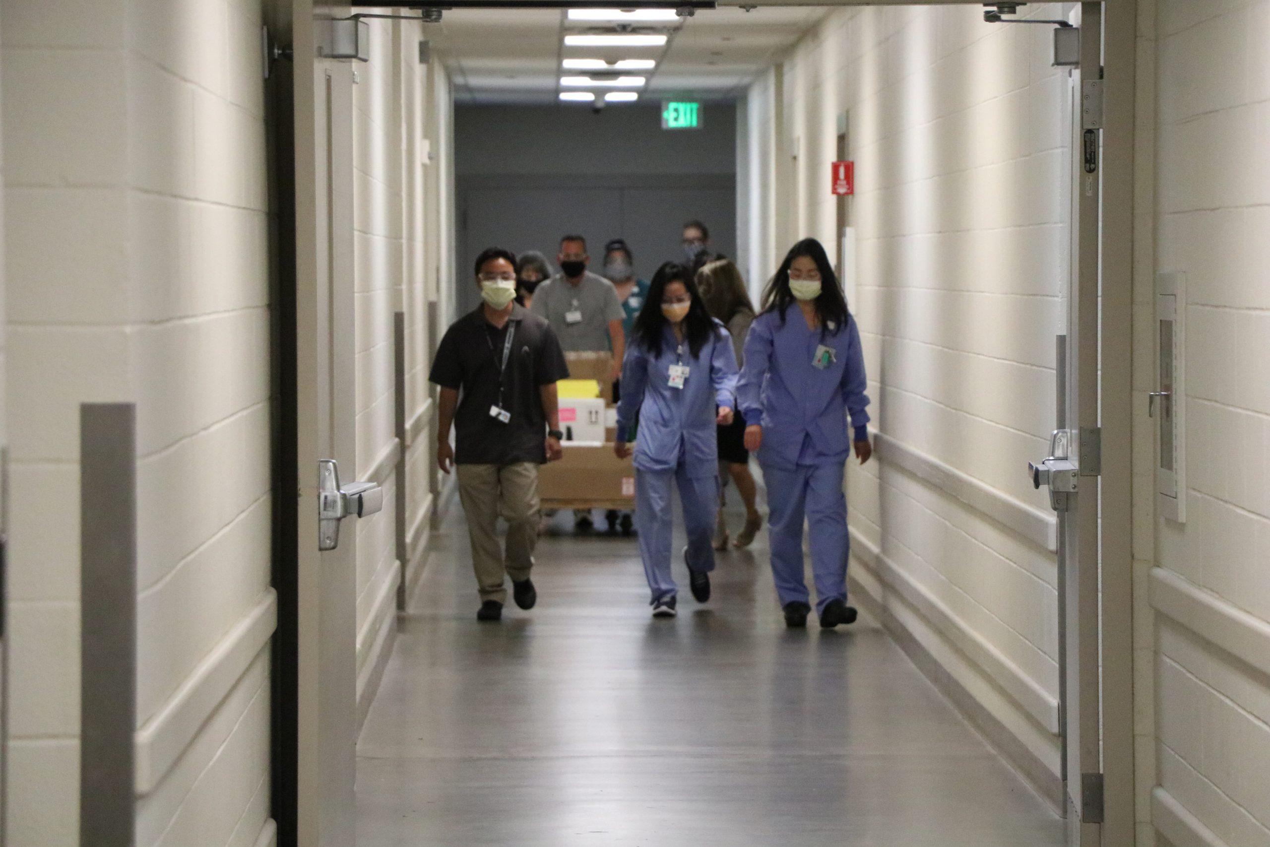 kapiolani medical center for women and children staff in a hallway