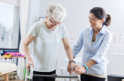 Caregiver helping woman with walker