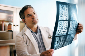 Doctor with Spinal Cord X-rays