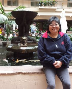 Photo: Val sitting by a fountain